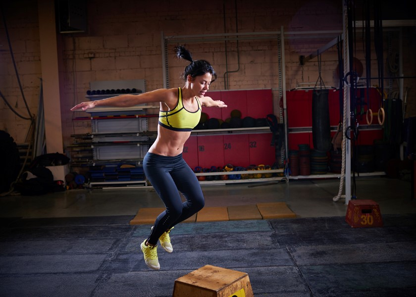 Female athlete doing rebounding box jumps