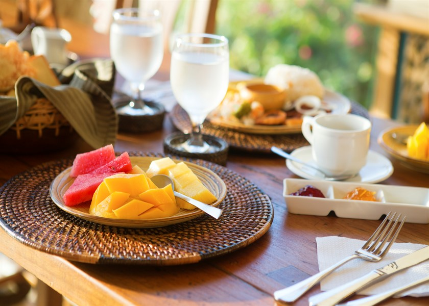 Delicious healthy breakfast with fruit selection and coffee